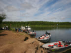 time-lapse of fishing parties preparing to desendTime-lapse of  several boats of fishermen preparing to depart river bank