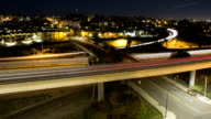 time-lapse of freeway overpass at night, long exposures