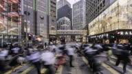 timelapse of people crossing street in financial district