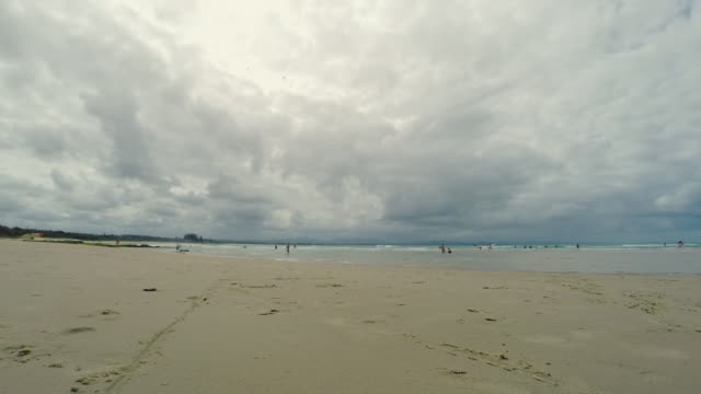 Time-lapse of people walking and swimming at Byron Bay Main Beach, New South Wales, Australia
