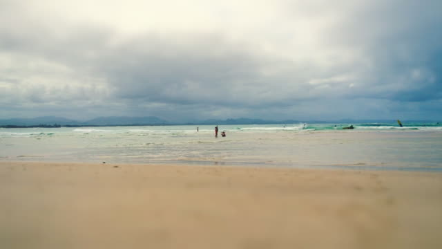 Time-lapse of people walking, under the sun and swimming at Byron Bay Main Beach, New South Wales, Australia