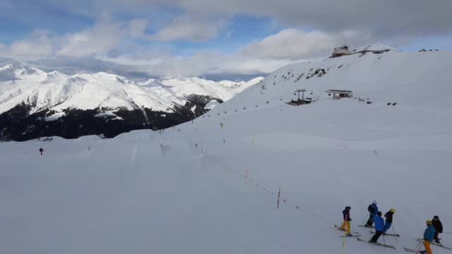 Timelapse of snow covered mountains in Davos Switzerland on Friday January 16 pan of mountains