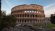 A time-lapse of the Colosseum and street traffic.