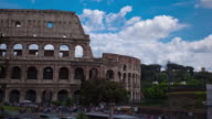 Time-lapse of the Colosseum and street traffic.