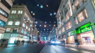 LONDON: TimeLapse of Traffic and people in Oxford St with Christmas Decorations