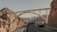 Time-lapse of traffic passing on Hoover Dam access road, beneath the bypass bridge.