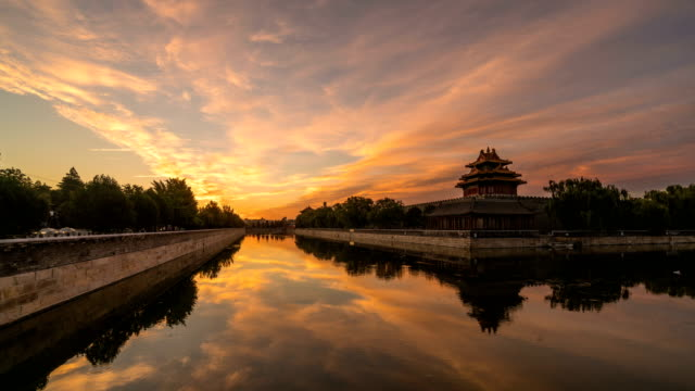 4K time-lapse of Turret Palace of Forbidden City at sunrise with reddened clouds