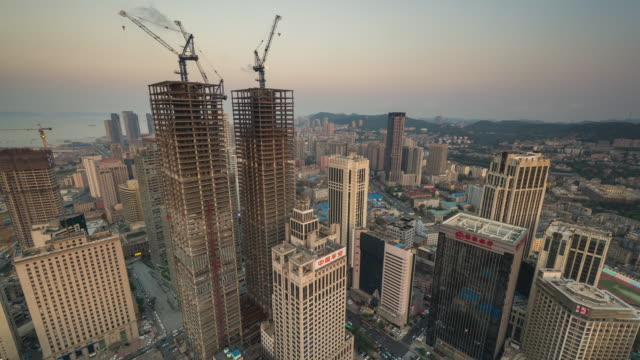 Timelapse of World Trade Building, Dalian, China from Day to Night