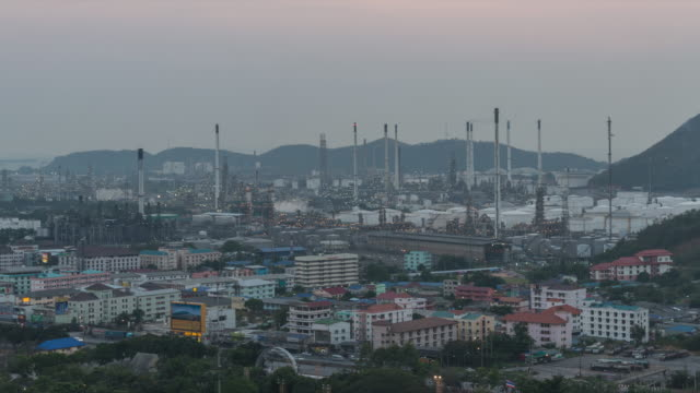 4K Time-lapse: Oil refinery plant petrochemical industry and transport at sunset time