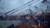 Timelapse on board CMA CGM SA's Benjamin Franklin container ship arriving at the Guangzhou Nansha Container Port in the early morning in the rain in...