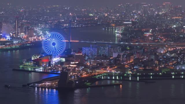 4K Time-lapse: Osaka bay at beautiful in the night time with fun park at beautiful in Japan, Zoom in