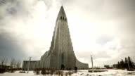 HD Time-lapse: Pedestrian at Hallgrimskirkja Cathedral Reykjavik Iceland
