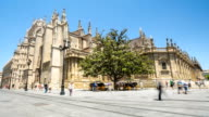 HD Time-lapse: Pedestrians at Seville Cathedral Square, Spain