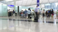 time-lapse people crowded at Hong Kong airport