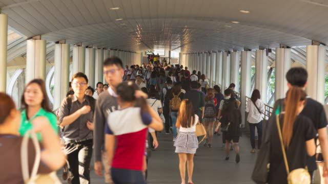 4K Time-lapse: People walking in skywalk Bangkok city.