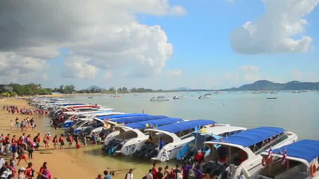 Timelapse pier boat transport on the beach