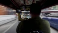 Timelapse POV of driver in a tuk tuk driving through traffic in Bangkok Thailand on Friday July 24 2015