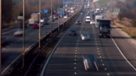 Timelapse, road transport.Tilt up to fast moving traffic on the M1 motorway at the busy M6 junction.