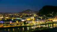 4K Time-lapse: Salzburg Cityscape along the river salzach Austria at dusk