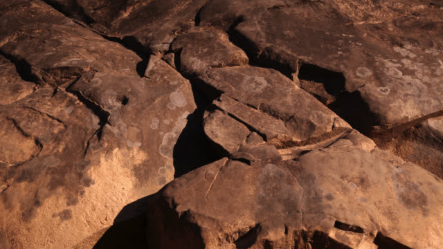 Timelapse shadows lengthen over rocks, Gwa, Myanmar
