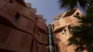 Timelapse shadows shift across face of building, Masdar, Abu Dhabi