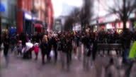 Timelapse shots shoppers at Manchester high street sea of heads crowd walking Exterior shot busker playing music Exterior Interview Chancellor George...
