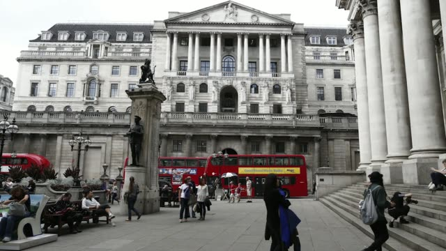 A timelapse shows pedestrians passing in front of the Bank of England in the City of London UK on Tuesday Sept 2 2014