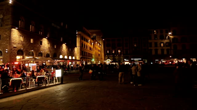 Time-lapse: Street scene in the old town of Florence with people at night