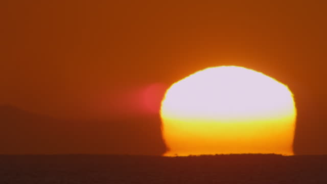 Timelapse MS sun rising from horizon over open sea