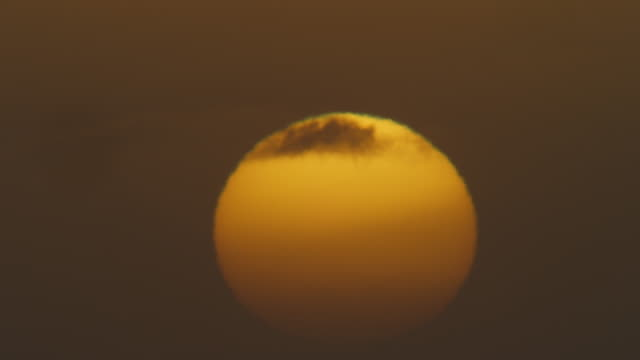 Timelapse MS sun rising into thin cloud