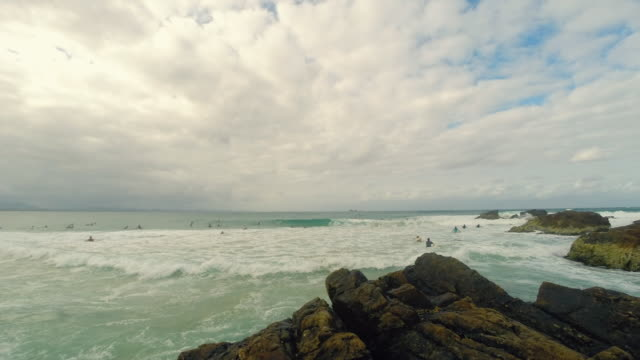 Time-lapse surfers at Byron Bay Main Beach, New South Wales, Australia