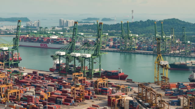 4K time-lapse: The Port of Singapore Warehouse is working import export, zoom out