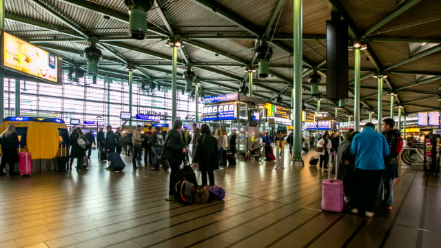 HD time-lapse: Traveler Airport station Terminal Schiphol Amsterdam Netherlands