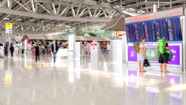 HD time-lapse: Traveler at Airport Departure Terminal