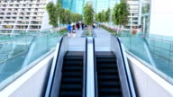 HD Time-lapse: Traveler at Escalator Pedestrian Bridge