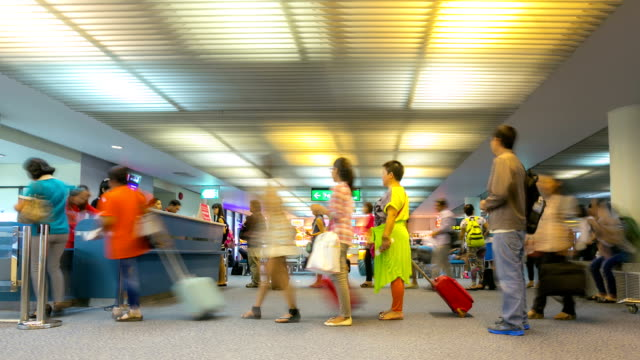 HD time-lapse: Traveler boarding at Airport gate