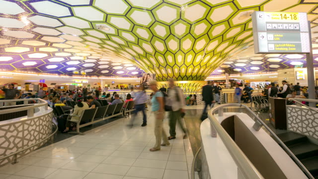 4K Time-lapse: Traveler Crowd abu dhabi Airport Departure waiting Hall