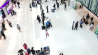 Timelapse: Traveler Crowd at Airport Arrival Hall