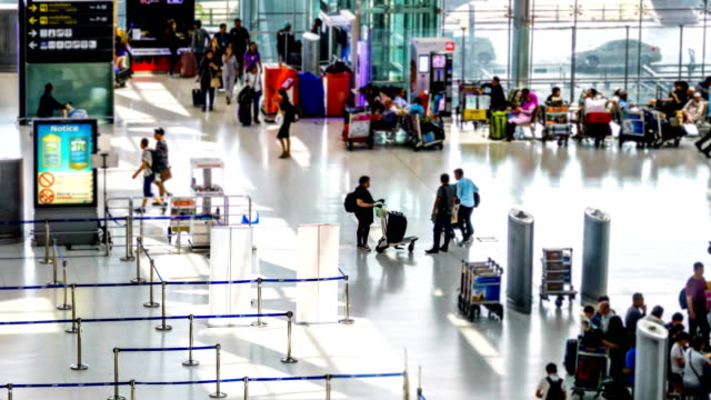 Time-lapse: Traveler Crowd at Airport Check In Counter Hall