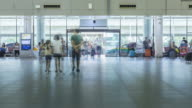 4K Time-lapse: Traveler Crowd at Airport Departure Hall Bangkok Donmuang with Taxi outside