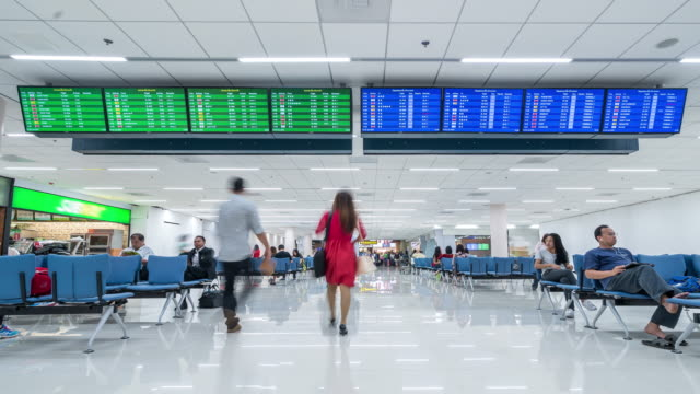 4K time-lapse: Traveler crowded at Airport Departure information board