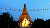 Timelapse twilight flags blowing in front of the Golden Stupa