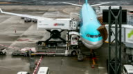 HD Time-lapse: Unloading airplane cargo air freight logistic background