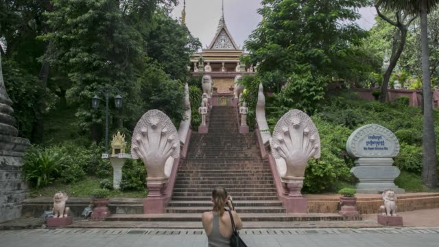 Timelapse visitors walk up and down the stairs at Wat Phnom in Phnom Penh Cambodia on Tuesday Nov 07 2017
