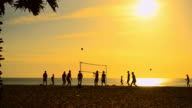 Timelapse volleyball on sunset beach