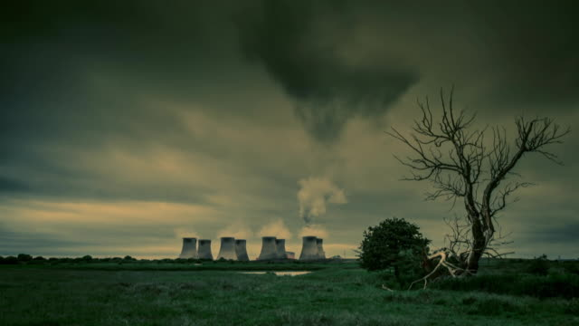 Time-lapse wide shot showing the chimneys of Ratcliffe-on-Soar power station under a moody sky, Nottinghamshire, UK.
