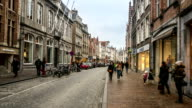 HD time-lapse zoom-out: Shopping street Historic town at Bruges Belgium