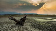 timelapse:cracked earth near dry lake in dry season