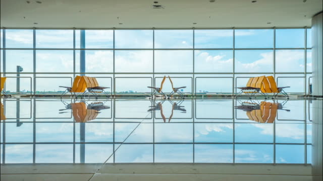 4K Time-lapsed of airport terminal waiting area with chairs in surabaya airport, Indonesia