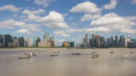4K Time-lapse:Fishing boats floating on river with city skyline in background,Hangzhou,China